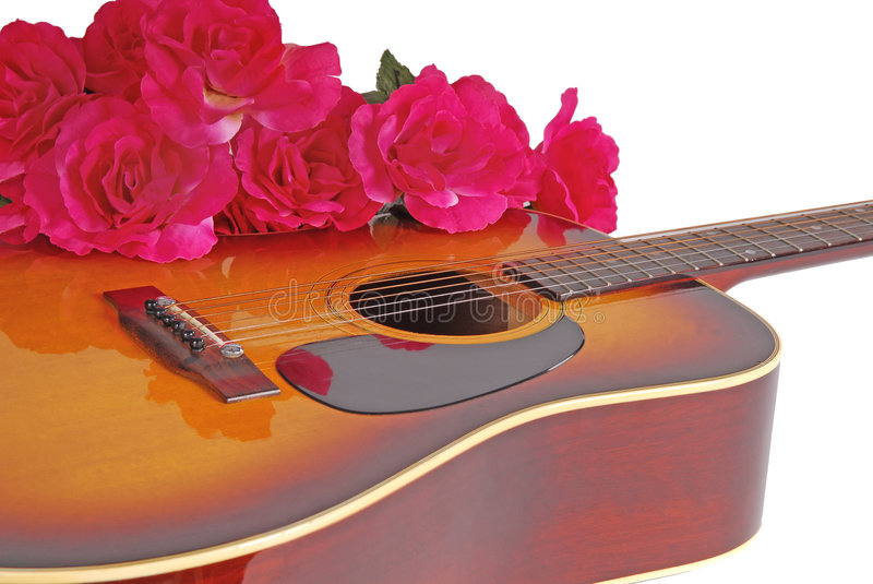 Guitar and Flowers. Acoustic guitar with bouquet of red flowers royalty free stock images