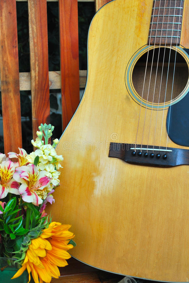 Guitar and Flowers Background Close-up stock photos