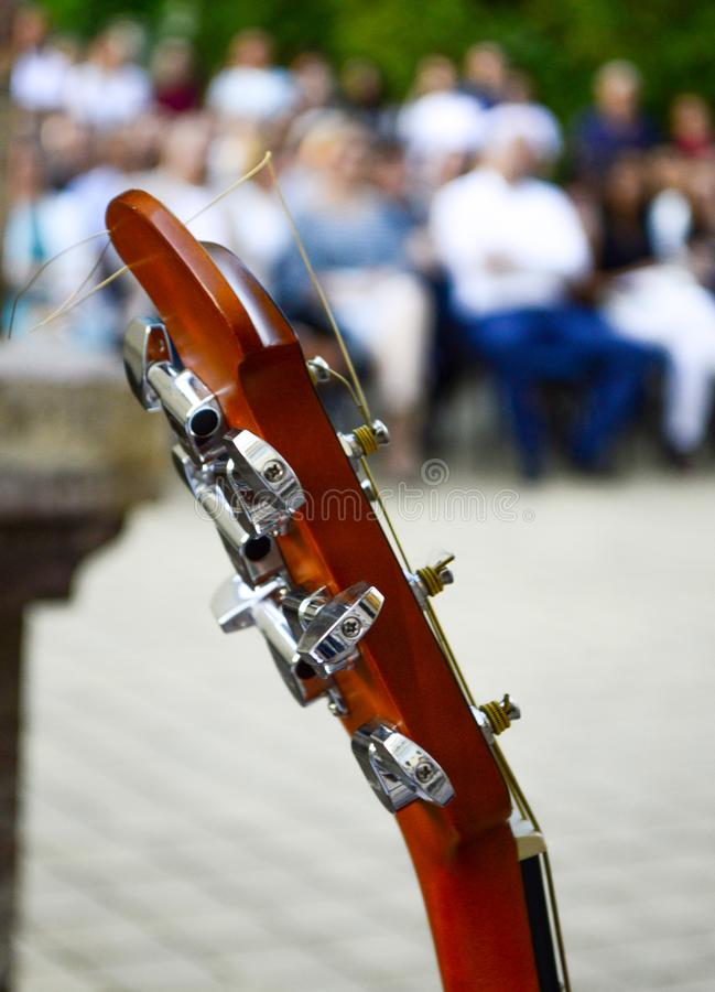 Guitar in front of audience ready to perform. Music theme stock image