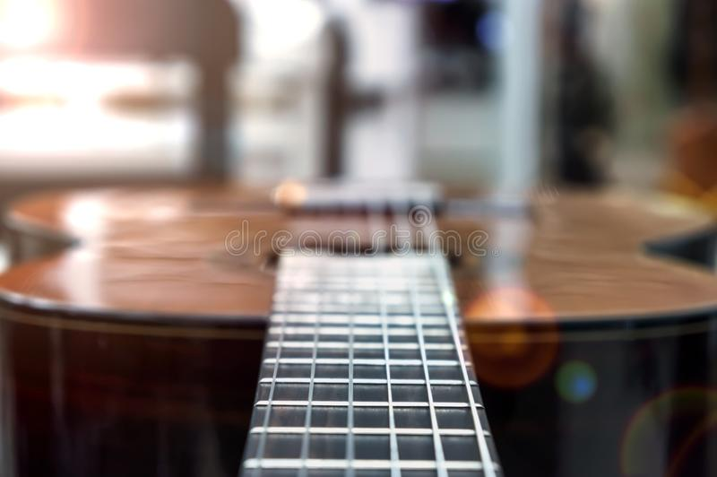 Guitar of a guitar close-up in horizontal position, soft focus. royalty free stock photo