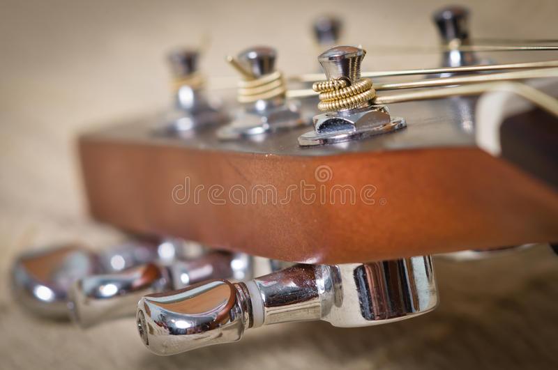 Guitar head. Acoustic guitar head with tuning pegs stock photo