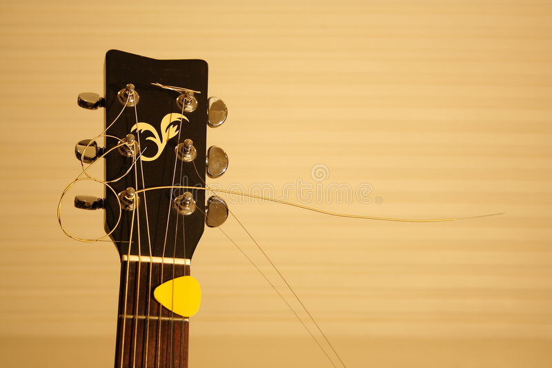 Guitar Head. Close up of a acoustic guitar head in yellow tone stock photo