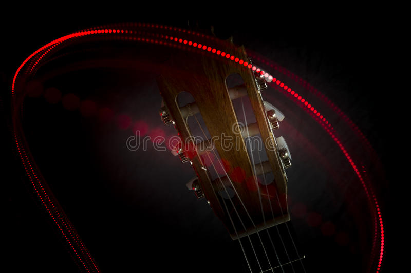 Download Guitar head and red light stock photo. Image of dancing - 90640078