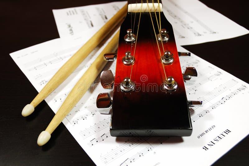 Guitar Headstock And Drum Sticks Stock Photos