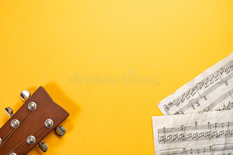 Guitar headstock and dummy musical score with copy space stock image