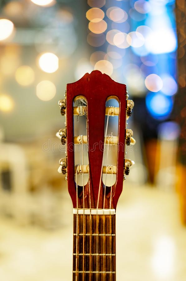 Guitar Headstock or Peghead with Blur Bokeh Background. Brown Guitar Headstock or Peghead with Blur Light Bokeh Background. Selective Focus stock images
