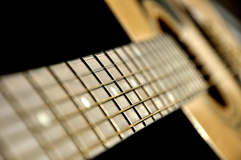 Guitar instr. Close up of guitar strings in a shallow DOF royalty free stock photo