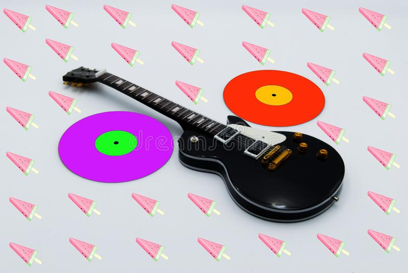 Guitar music icon. Zine culture style. Studio shot royalty free stock images