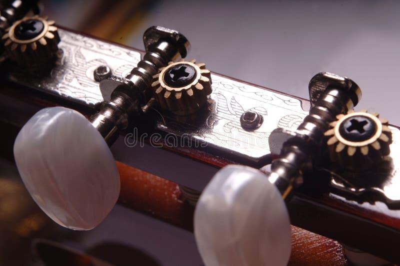 Guitar neck. Close up of guitar keys royalty free stock photo