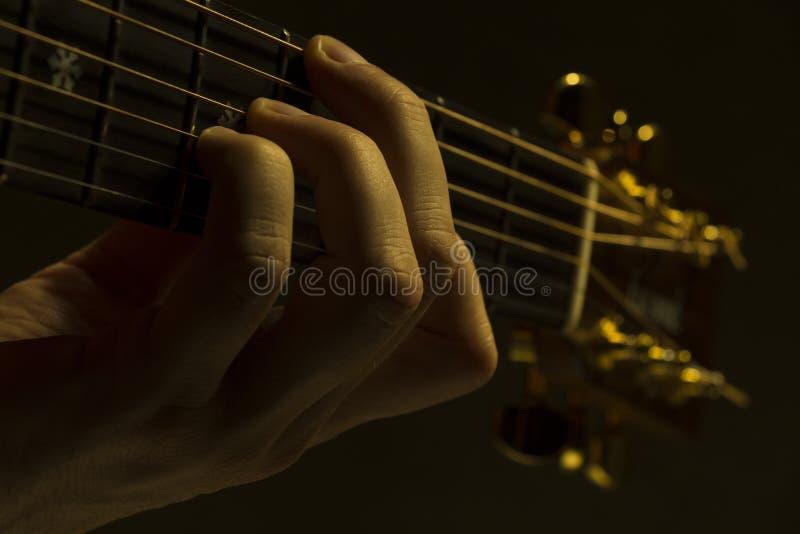 Guitar neck under dramatic light stock photography