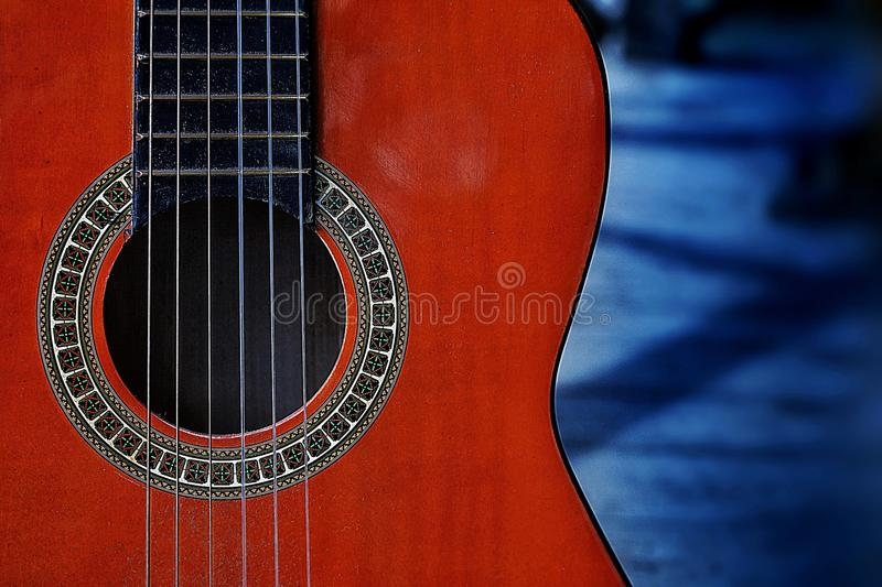 guitar orange color backgrounds wood shadow outdoors musical instrument blue color textured stock images