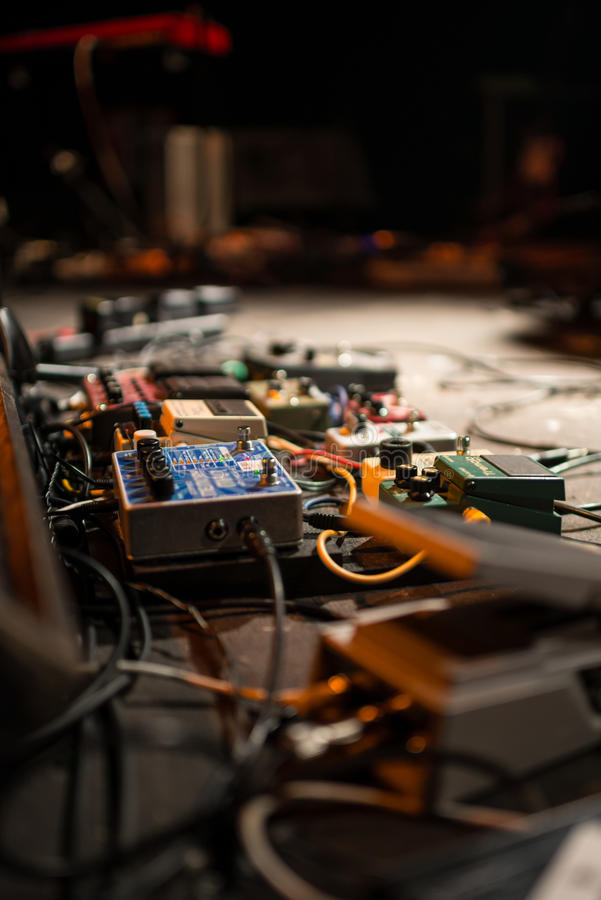Guitar pedal and cables royalty free stock images