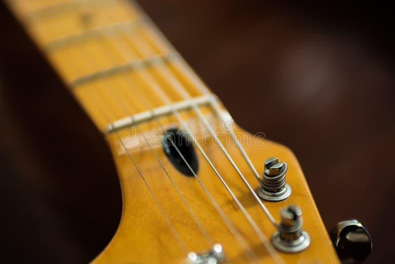 Guitar pegs on guitar headstock stock image