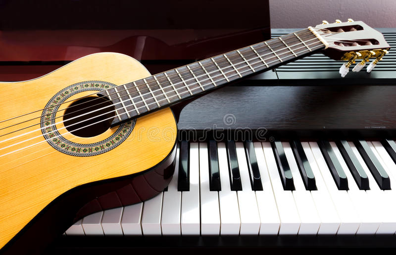 Guitar and piano stock photography
