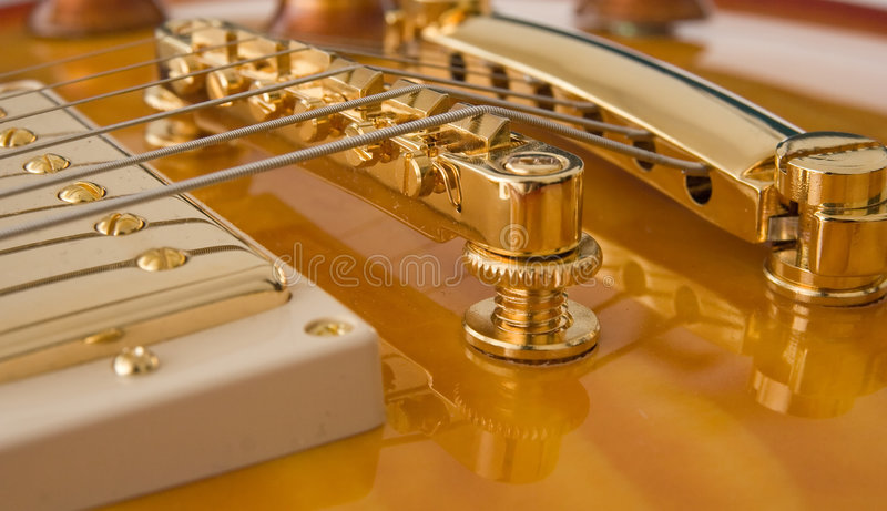 Guitar Pickup and Bridge. A closeup of a pickup and bridge / tailpiece on an Epiphone Les Paul stock images