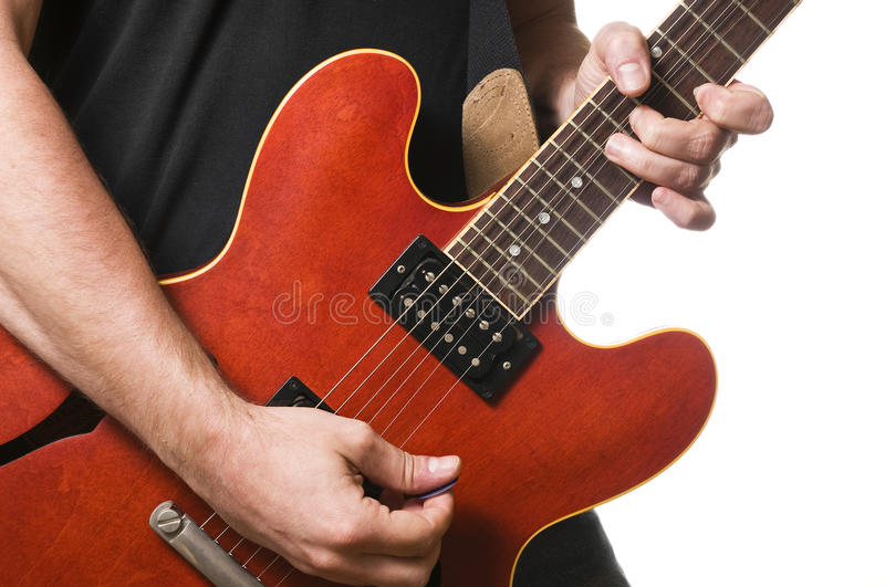 Guitar player. On white background stock image