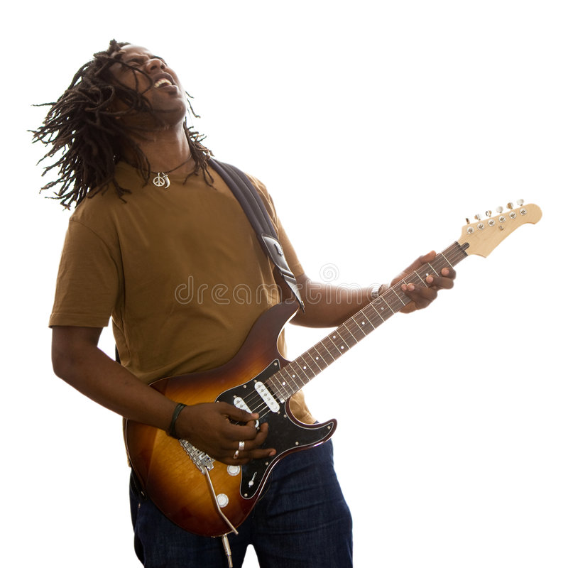 Guitar Player. African adult male with dreadlocks flying jamming on a guitar on a white background royalty free stock images