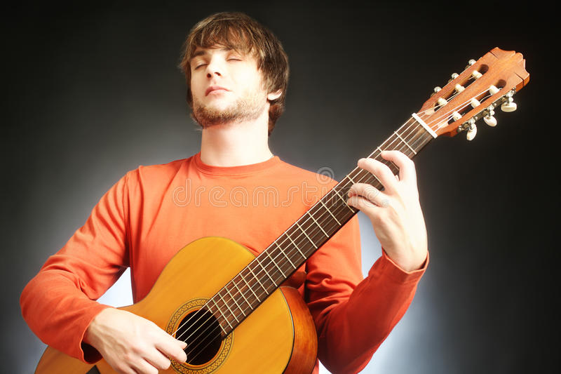 Guitar player Acoustic guitarist. Playing classical music instruments stock photo
