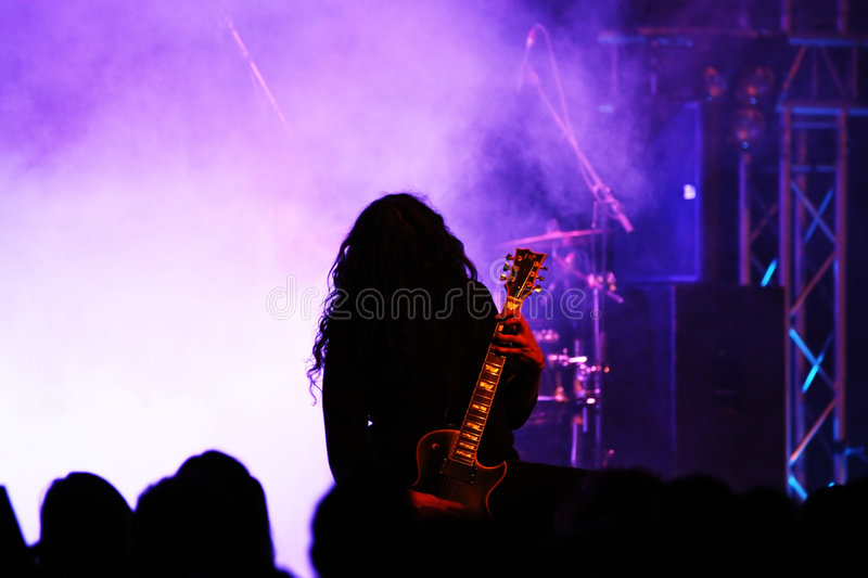 Guitar player in action stock photography