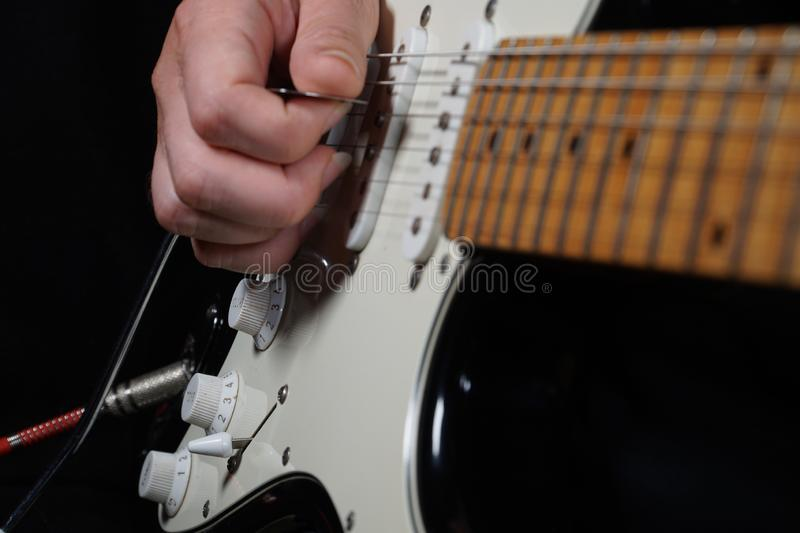 Guitar player on black background royalty free stock photos