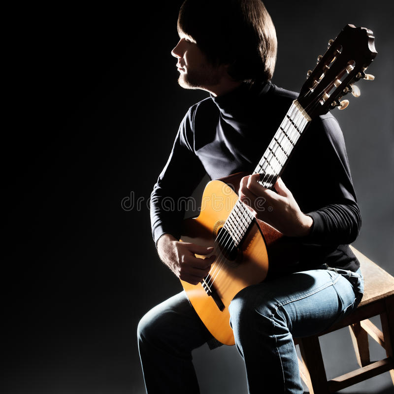 Guitar player on the concert. Acoustic guitar player on the concert. Guitarist man with classical musical instrument stock image