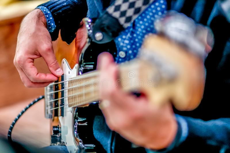 Guitar player detail. Music art playing bass royalty free stock images