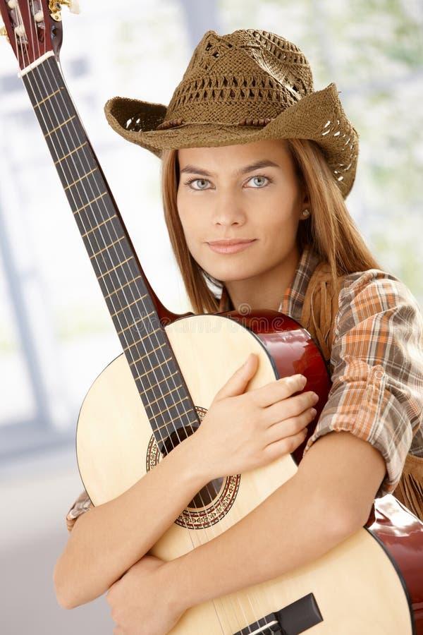 Guitar Player Girl Hugging Guitar Smiling Royalty Free Stock Images