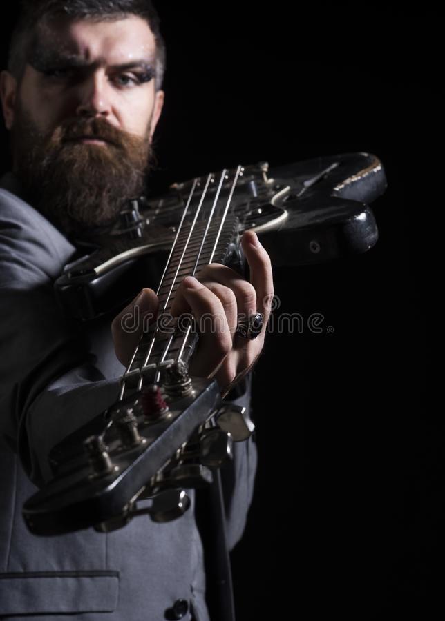 Guitar player hold electric instrument. Bearded man play guitar chord. Musician with guitar. My guitar gently weeps stock images
