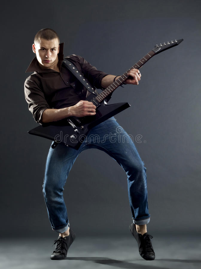 Download Guitar Player Isolated Against Dark Background Stock Photo - Image: 17967686
