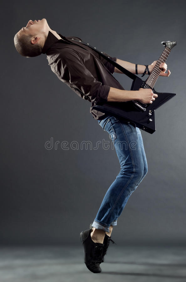Guitar Player Playing His Guitar O Royalty Free Stock Photos