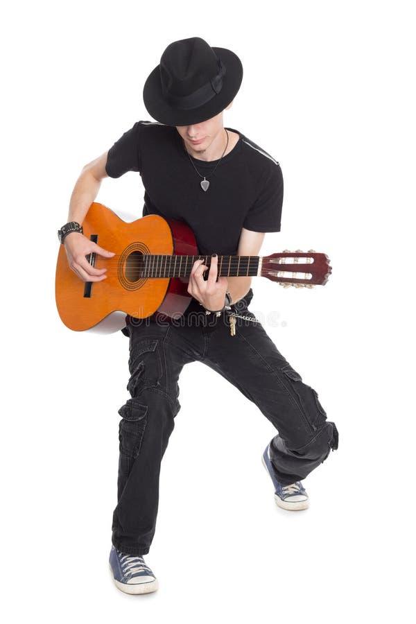 Guitar player playing his guitar royalty free stock image
