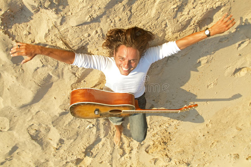 Guitar Player In The Sand Royalty Free Stock Photos