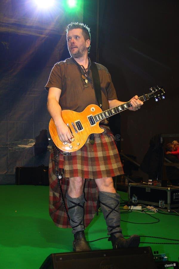 Guitar player of the Saor Patrol group royalty free stock photos