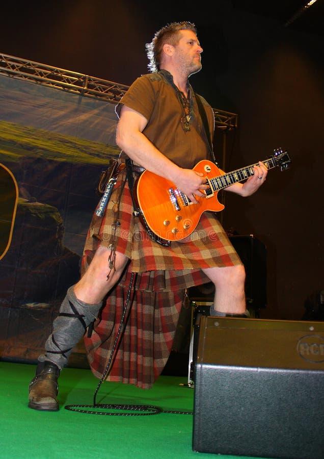 Guitar player of the Saor Patrol group stock photos