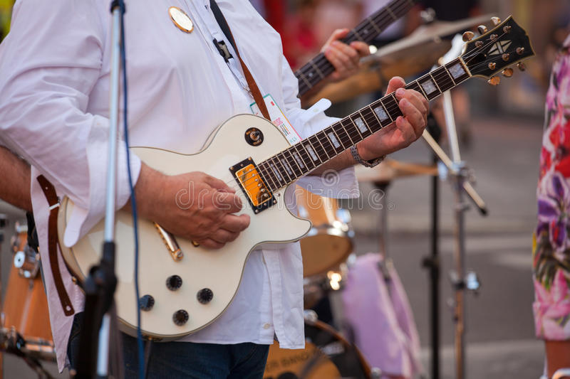 Guitar player. During the street concert royalty free stock photography