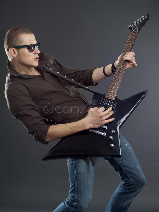 Guitar player with sunglasses royalty free stock image
