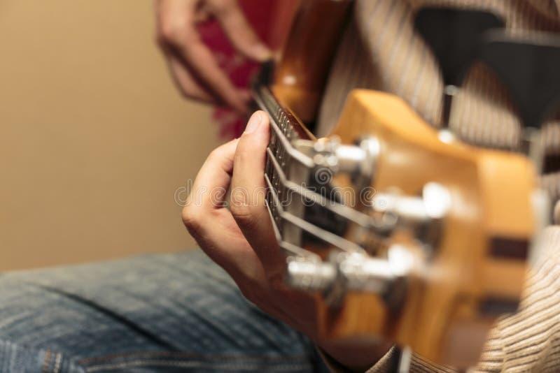 Guitar playing close-up royalty free stock photo