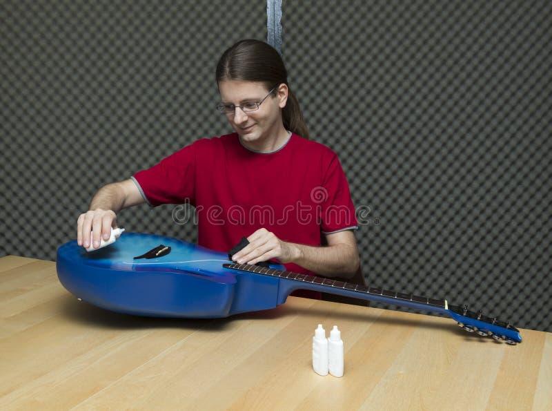 Guitar polishing royalty free stock image