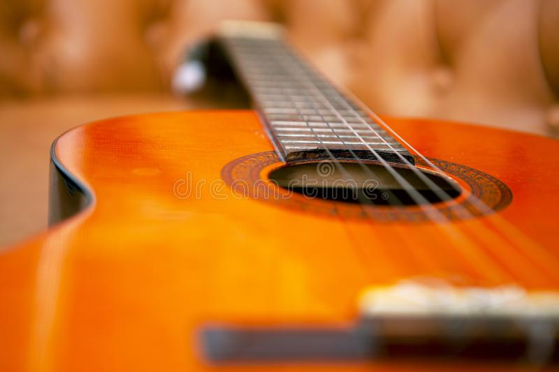 Guitar In The Sofa. Classic Guitar In The Sofa ready to play royalty free stock photos