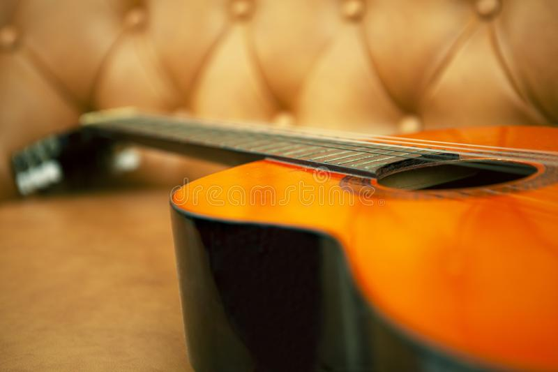 Guitar In The Sofa. Classic Guitar In The Sofa ready to play stock image