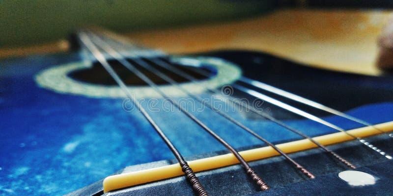 Guitar strings close-up shots. Stringsblie, blue, portrait, songs stock photo