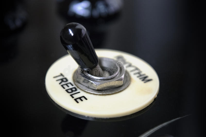 Guitar switch for treble and rhythm stock image