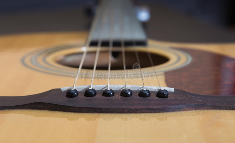 Guitar - tailpiece with strings. Soft focus put only on tailpiece stock photos