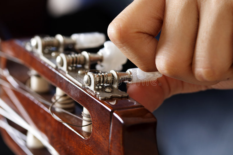 Guitar tuning royalty free stock photo