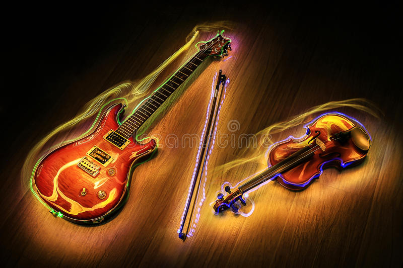 Guitar and violin with light painting royalty free stock photos