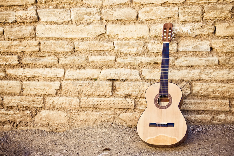 Guitar on wall stock images