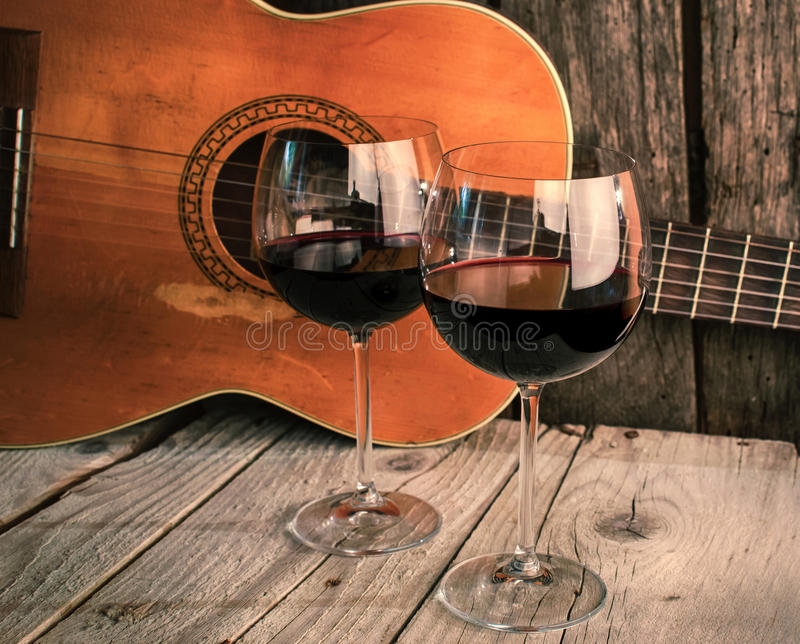 Guitar and Wine on a wooden table romantic dinner. Background stock photo