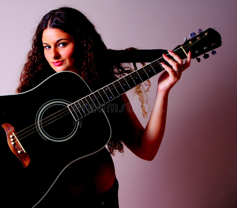 Guitar on a Woman royalty free stock image
