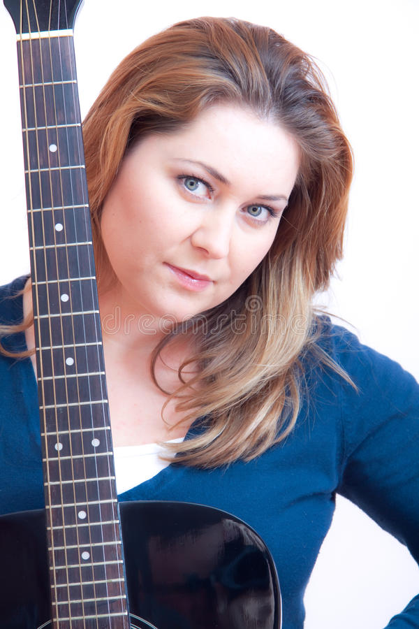 Guitar woman. Woman with accoustic guitar stock image