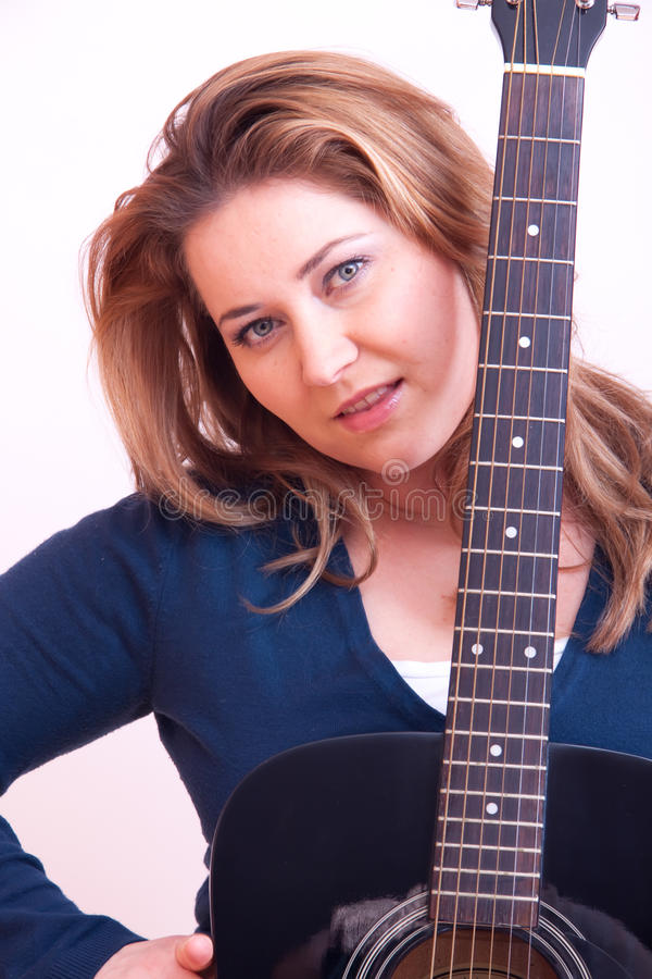 Guitar woman. Woman with accoustic guitar royalty free stock photos